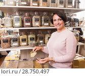 Купить «woman buyer selects herbs in store of ecological products», фото № 28750497, снято 14 июля 2018 г. (c) Татьяна Яцевич / Фотобанк Лори