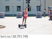 Купить «Tyumen, Russia, on July 15, 2018: the Russian girl rides a giroskuter in the summer on the square», фото № 28751745, снято 15 июля 2018 г. (c) Землянникова Вероника / Фотобанк Лори
