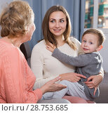 Купить «Aged woman is sharing her experience with daughter for upbringing toddler», фото № 28753685, снято 15 февраля 2018 г. (c) Яков Филимонов / Фотобанк Лори