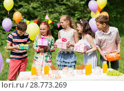 Купить «happy kids with gifts on birthday party at summer», фото № 28773269, снято 27 мая 2018 г. (c) Syda Productions / Фотобанк Лори