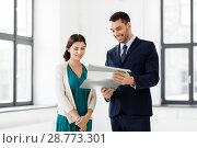 Купить «realtor with folder showing documents to customer», фото № 28773301, снято 8 июня 2018 г. (c) Syda Productions / Фотобанк Лори