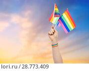Купить «hand with gay pride rainbow flags and wristband», фото № 28773409, снято 2 ноября 2017 г. (c) Syda Productions / Фотобанк Лори