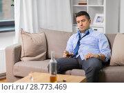 Купить «alcoholic with glass drinking whiskey at home», фото № 28773469, снято 24 ноября 2017 г. (c) Syda Productions / Фотобанк Лори