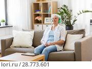 Купить «senior woman in headphones listening to music», фото № 28773601, снято 24 мая 2018 г. (c) Syda Productions / Фотобанк Лори