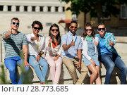 Купить «friends in sunglasses in city showing thumbs up», фото № 28773685, снято 10 июня 2018 г. (c) Syda Productions / Фотобанк Лори