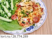 Купить «Яичница с сосисками и помидорами», эксклюзивное фото № 28774289, снято 14 июля 2018 г. (c) Dmitry29 / Фотобанк Лори