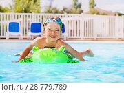 Купить «Boy swimming with inflatable toy in the pool», фото № 28779789, снято 25 июля 2017 г. (c) Сергей Новиков / Фотобанк Лори