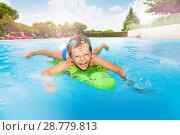 Купить «Funny boy swimming with inflatable crocodile», фото № 28779813, снято 22 октября 2018 г. (c) Сергей Новиков / Фотобанк Лори