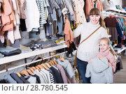 Купить «Woman with her daughter chose clothes for kids», фото № 28780545, снято 10 января 2017 г. (c) Яков Филимонов / Фотобанк Лори