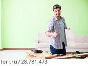 Купить «Woodworker working in his workshop», фото № 28781473, снято 15 мая 2018 г. (c) Elnur / Фотобанк Лори