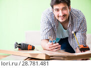 Купить «Woodworker working in his workshop», фото № 28781481, снято 15 мая 2018 г. (c) Elnur / Фотобанк Лори