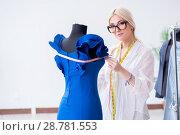 Купить «Woman tailor working on new dress designs», фото № 28781553, снято 13 апреля 2018 г. (c) Elnur / Фотобанк Лори
