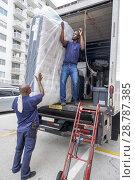 Купить «Florida, Miami Beach, mattress delivery truck, Black, man, delivering, unloading, dolly, manual labor,», фото № 28787385, снято 18 октября 2017 г. (c) age Fotostock / Фотобанк Лори