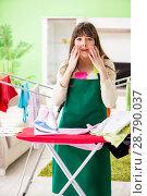 Купить «Young woman ironing clothing at home», фото № 28790037, снято 29 мая 2018 г. (c) Elnur / Фотобанк Лори