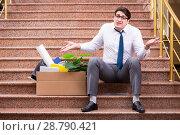 Купить «Young businessman on the street after dismissal», фото № 28790421, снято 30 марта 2017 г. (c) Elnur / Фотобанк Лори