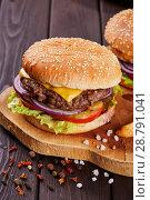 Купить «Tasty fresh meat burgers with salad and cheese served on wooden board.», фото № 28791041, снято 17 апреля 2018 г. (c) Евгений Глазунов / Фотобанк Лори