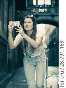 Купить «Girl holding phone and photographing», фото № 28791169, снято 17 мая 2017 г. (c) Яков Филимонов / Фотобанк Лори
