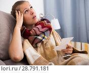 Купить «ill female with pills and recipe on sofa», фото № 28791181, снято 4 октября 2017 г. (c) Яков Филимонов / Фотобанк Лори