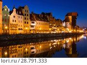 Купить «View on illumination of night embankment of Moltawa River in Gdansk», фото № 28791333, снято 12 мая 2018 г. (c) Яков Филимонов / Фотобанк Лори