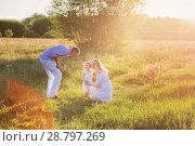 Купить «happy family in summer park at sunset», фото № 28797269, снято 10 июля 2018 г. (c) Майя Крученкова / Фотобанк Лори