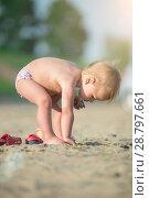 Купить «Cute baby playing with toys on sandy beach near the sea.», фото № 28797661, снято 24 июня 2014 г. (c) Александр Маркин / Фотобанк Лори