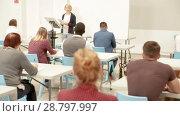 Купить «Female speaker giving presentation for adult students in lecture hall», видеоролик № 28797997, снято 22 мая 2018 г. (c) Яков Филимонов / Фотобанк Лори