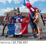 Купить «MOSCOW - JUNE 26, 2018: Soccer World Cup Fanatics of France with flags with their typical costumes in the streets June 26, 2018 in Moscow, Russia», фото № 28798497, снято 26 июня 2018 г. (c) Фотограф / Фотобанк Лори