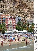 Купить «Tourists sunbathing on a Postiguet Beach of Alicante city. Spain», фото № 28805317, снято 26 июня 2018 г. (c) Alexander Tihonovs / Фотобанк Лори