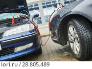 Купить «Automobile help. booster jumper cables charging automobile discharged battery», фото № 28805489, снято 1 апреля 2018 г. (c) Дмитрий Калиновский / Фотобанк Лори