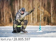 Купить «winter fishing on ice. fisherman or angler hooking the fish», фото № 28805597, снято 17 марта 2018 г. (c) Дмитрий Калиновский / Фотобанк Лори