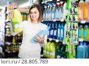 Купить «woman choosing best cleaners for home in supermarket», фото № 28805789, снято 23 ноября 2016 г. (c) Яков Филимонов / Фотобанк Лори