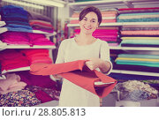 Купить «Woman choosing fabric», фото № 28805813, снято 4 января 2017 г. (c) Яков Филимонов / Фотобанк Лори