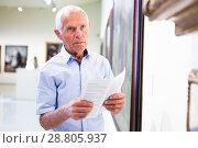 Купить «Man visiting painting exhibition», фото № 28805937, снято 9 июня 2018 г. (c) Яков Филимонов / Фотобанк Лори