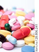 Купить «Group of multicolored medical pills and capsules», фото № 28806241, снято 7 августа 2017 г. (c) Pavel Biryukov / Фотобанк Лори