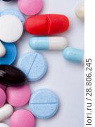 Купить «Top view of colorful medical pills and capsules», фото № 28806245, снято 7 августа 2017 г. (c) Pavel Biryukov / Фотобанк Лори