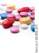 Купить «Colorful medical pills on white background», фото № 28806257, снято 7 августа 2017 г. (c) Pavel Biryukov / Фотобанк Лори