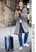 Купить «Girl holding camera and photographing», фото № 28807993, снято 27 марта 2017 г. (c) Яков Филимонов / Фотобанк Лори