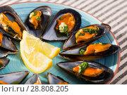Купить «Mussels with herbs on plate», фото № 28808205, снято 25 июня 2018 г. (c) Яков Филимонов / Фотобанк Лори
