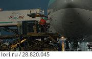 Купить «Loading cargo onto the plane with container loader», видеоролик № 28820045, снято 4 октября 2017 г. (c) Данил Руденко / Фотобанк Лори