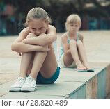 Купить «Two offended girls after quarrel outdoors», фото № 28820489, снято 20 июля 2017 г. (c) Яков Филимонов / Фотобанк Лори