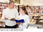 Купить «man with daughter looking for interesting books», фото № 28820633, снято 22 февраля 2018 г. (c) Яков Филимонов / Фотобанк Лори