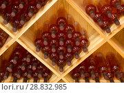 Купить «Бутылки виноградного вина в винном погребе», фото № 28832985, снято 9 июня 2018 г. (c) Наталья Волкова / Фотобанк Лори