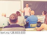 Купить «Young lecturer talking to mixed age students», фото № 28833033, снято 28 июня 2018 г. (c) Яков Филимонов / Фотобанк Лори