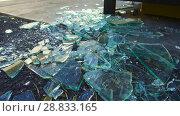 Купить «shards of broken glass on floor», видеоролик № 28833165, снято 5 июля 2018 г. (c) Syda Productions / Фотобанк Лори