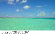 Купить «lagoon at tropical beach in french polynesia», видеоролик № 28833361, снято 3 июля 2018 г. (c) Syda Productions / Фотобанк Лори