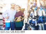 Купить «Young woman with man in helmet with instruments», фото № 28833489, снято 16 февраля 2018 г. (c) Яков Филимонов / Фотобанк Лори