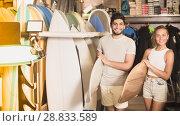Купить «couple surfers holding surfboard», фото № 28833589, снято 22 августа 2017 г. (c) Яков Филимонов / Фотобанк Лори