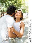 Купить «happy adult man and woman meeting and kissing on the street», фото № 28833617, снято 22 августа 2017 г. (c) Яков Филимонов / Фотобанк Лори