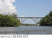 Very high arched bridge over a wide river (2018 год). Стоковое фото, фотограф Моисеев Дмитрий / Фотобанк Лори