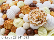 Купить «A lot of sweets, such as: marshmallows, sweets, chocolate, biscuits, nuts as a background or backdrop», фото № 28841393, снято 26 июня 2018 г. (c) Олег Белов / Фотобанк Лори